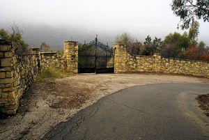 Security gates still stand at the former entrance to the compound
