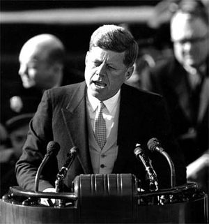 JFK speaking at podium