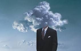 man in suite cloudy head