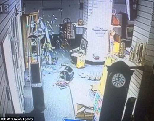 Caught on video: Spooky moment glass cabinet opens by itself and shatters into pieces in locked, empty room