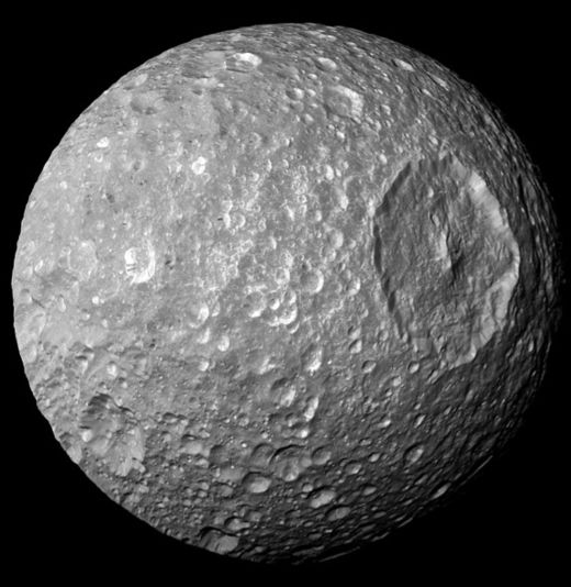 Solar-system-wide climate change: Scientists puzzled by 'wobble' of Saturn moon Mimas 141016143656_large
