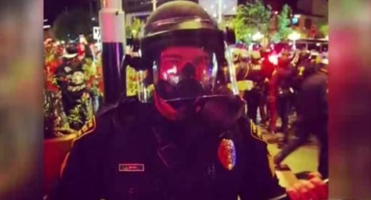 Arizona riot cop filmed slamming peaceful people to the ground