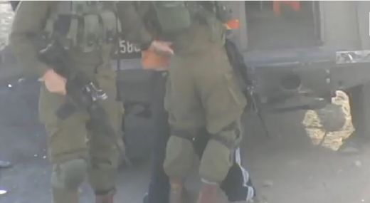 Israeli soldiers arrest 11 year-old disabled Palestinian boy for throwing stones as settlers chant 'death to Arabs' (Video)