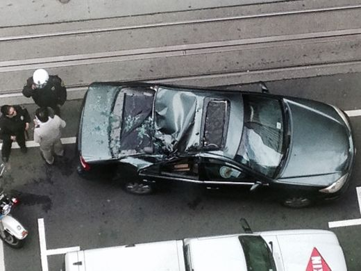 Window washer survives 11 story fall by landing on a moving car