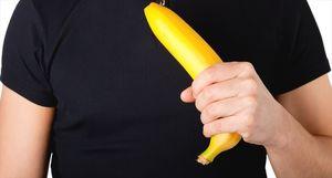 man holding banana