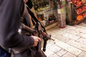 israeli settler opens fire market