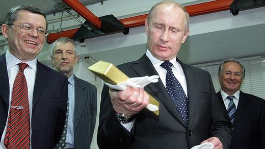 Putin holding gold