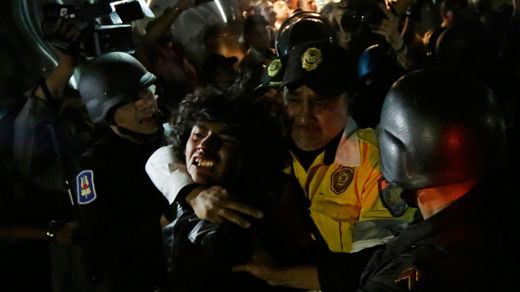 Violent arrests as hundreds rally over 43 missing students in Mexico