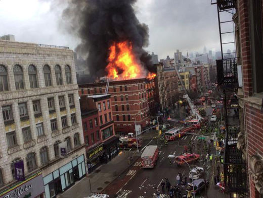 Explosion rocks Manhattan - people trapped in collapsed and burning building