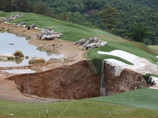 Huge sinkhole swallows pond and bunkers after appearing on US golf course