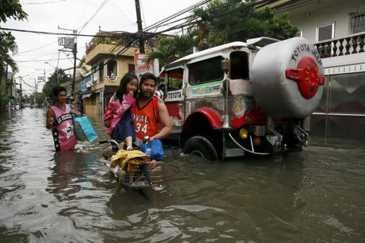 Tropical storm Linfa brings flooding and landslides to Philippines