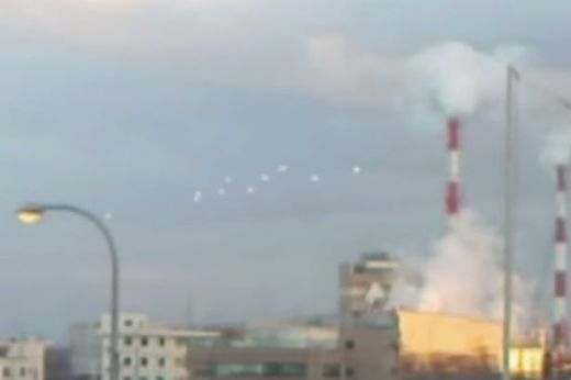 10 white globes filmed floating in sky above Osaka, Japan