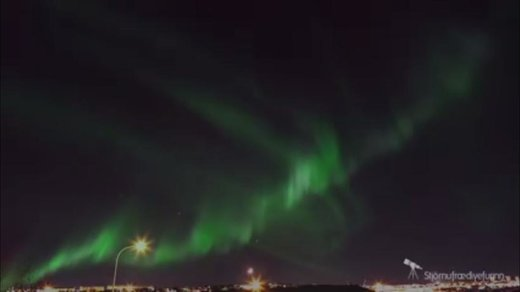 Bright meteor shoots through Northern Lights over Iceland