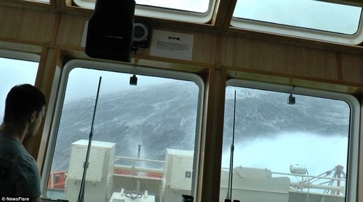 Ship faced with terrifying 100-foot waves during North Sea storm caught on film