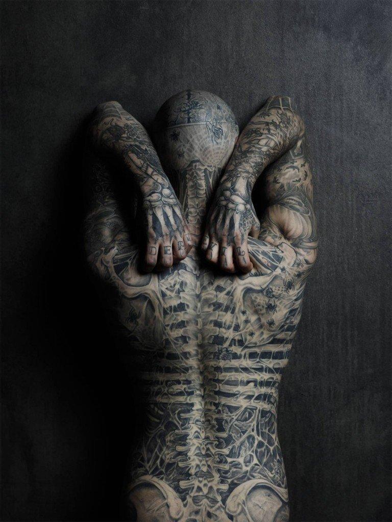 heavy tattooed stud abusing himself