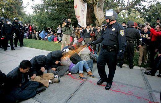 A University of California Davis police officer pepper-sprays students