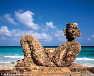 A Mayan sculpture installed near a beach