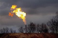 A gas flare burns at a fracking site in rural Bradford County, Pennsylvania January 9, 2012.