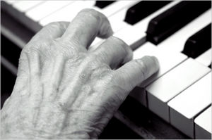 elderly hands playing piano