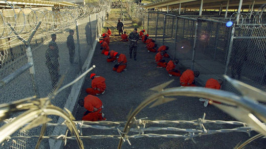 Detainees in orange jumpsuit