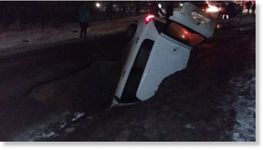 Sinkhole swallows car