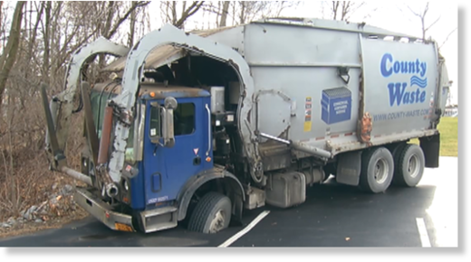 Garbage truck in sinkhole