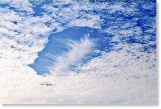 hole punch cloud over Atmore, Al