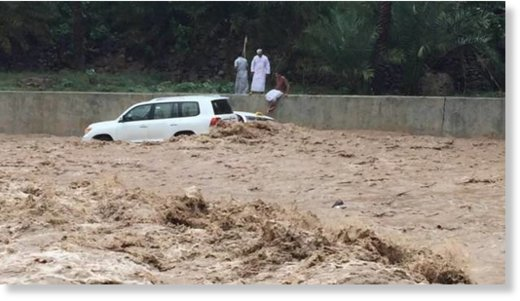 A taxi washed away by floodwaters smashes into a four-wheel-drive during heavy rains in Oman on Friday.