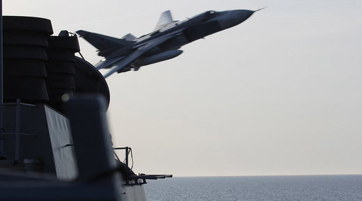 A Sukhoi Su-24 jet makes a low altitude pass by the USS Donald Cook