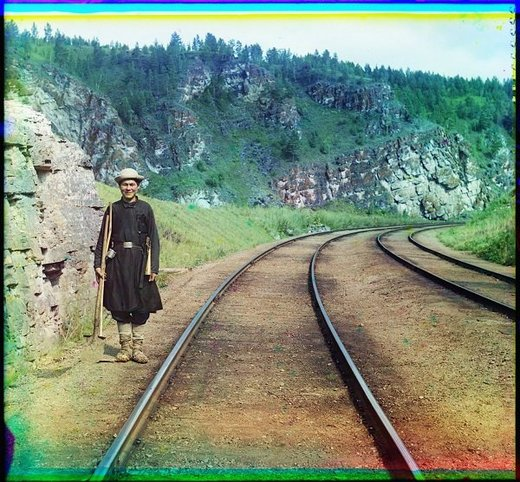 A switch operator poses on the Trans-Siberian Railroad near the town of Ust Katav on the Yuryuzan River. (1910)