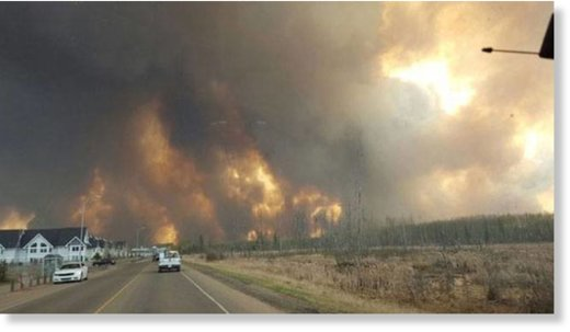 Residents fleeing the forest fire in Fort McMurray, Canada.