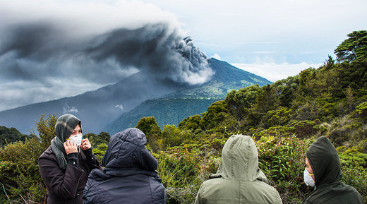 People look at the Turrialba volcano as it spewes ashes on May 20, 2016, in Cartago, Costa Rica