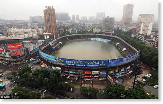 The football stadium in Erzhou was left completely swamped after heavy rain battered the city