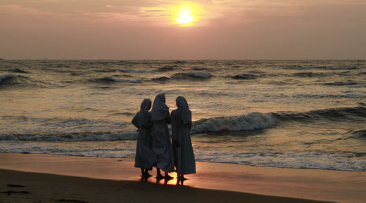 Nuns on Italian beach sunset