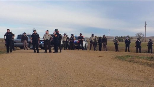 Cops with riot gear, armored vehicle, LRAD surround 5 praying Native Americans at Dakota pipeline protests
