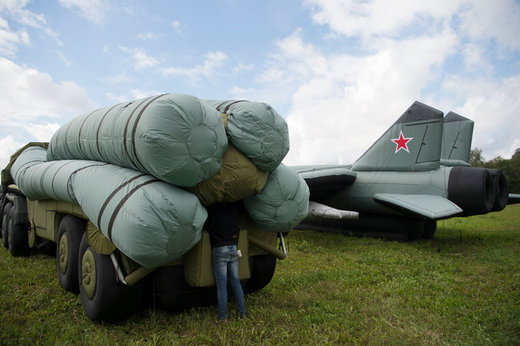 Rusbal employees inflating a mock S-300 missile system