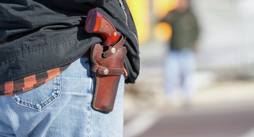 Man carrying handgun