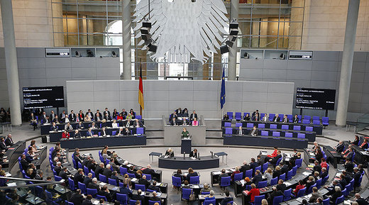 German Chancellor Angela Merkel speaks during a meeting at the lower house of parliament