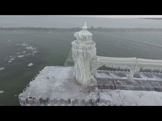 Resembling a scene from 'The Day After Tomorrow': Chilly winter turns Michigan lighthouse into frozen castle