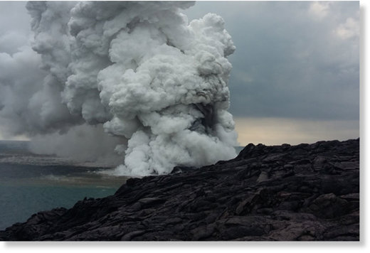 A large plume of rock debris and gas emanates from the Kamokuna lava ocean entry within Hawaii Volcanoes National Park, just moments after the lava delta began to collapse.