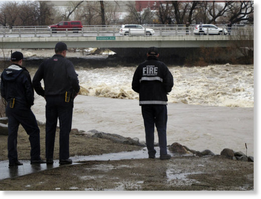 Sparks firefighters monitor the rising Truckee River, Sunday, Jan. 8, 2017, where it runs near the Grand Sierra hotel-casino along a line that divides the cities of Reno and Sparks, Nev.