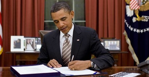 Obama signing Surveillance Power EO