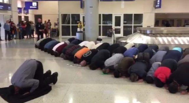 Protesting Muslims Take Prayer Break At Dallas Airport