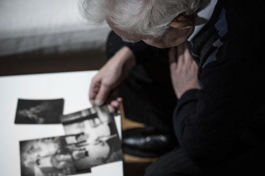 older man looking at pictures