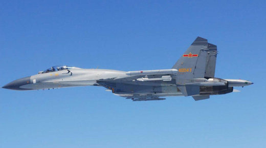 A Chinese SU-27 fighter flies over the East China Sea