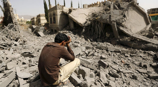 Grieving man in Yemen destruction