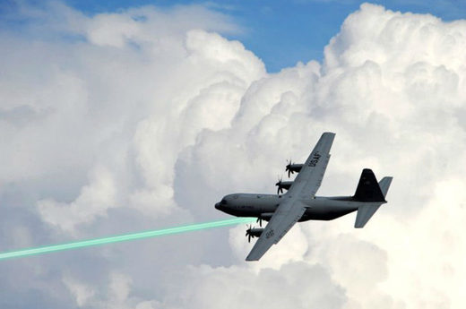 Photo illustration of an AC-130 gunship firing a laser weapon