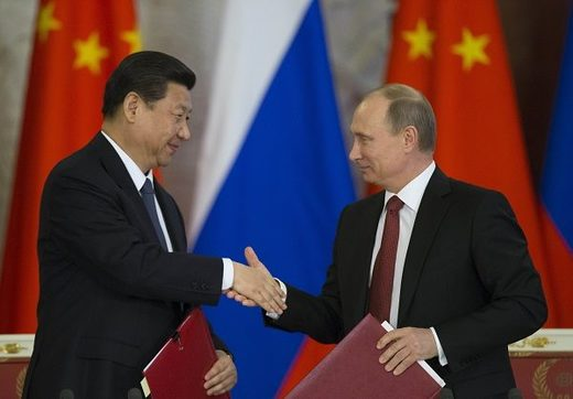 China reaffirms its alliance with Russia as top Chinese officials visit Putin in Moscow