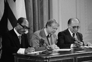 President Jimmy Carter signing the Camp David peace agreement with Egypt's Anwar Sadat and Israel's Menachem Begin