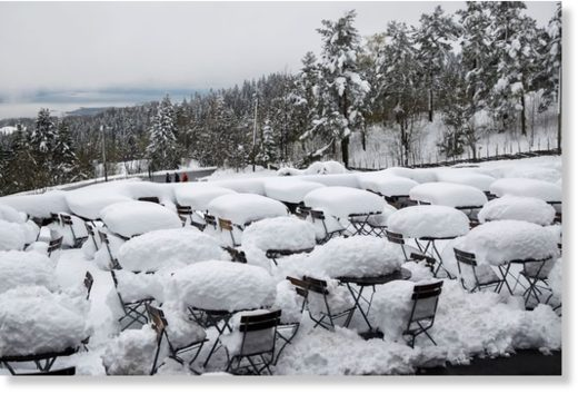 Snow covers an outdoor cafe in Holmenkollen, Oslo, Norway, on May 11, 2017